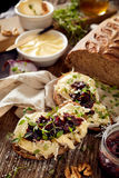 Sandwiches with rustic bread with goat cheese, caramelized red onion jam and fresh thyme. On wooden table royalty free stock photo
