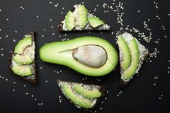 Sandwiches of rye bread with avocado and cream cheese, top view stock photo