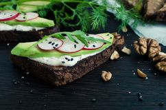 Sandwiches of rye bread with avocado and goat cheese Stock Images