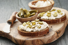 Sandwiches with rye bread, cream cheese and marinated cucumbers Royalty Free Stock Images