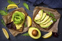 Sandwiches with rye bread and fresh sliced avocado. Sandwiches with rye bread, guacamole and fresh avocados royalty free stock photo