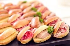 Sandwiches (salami, cheese, fois gras, ham) Stock Images