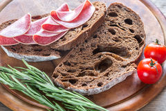 Sandwiches with salami. Sandwiches with dark-rye bread and salami Stock Image