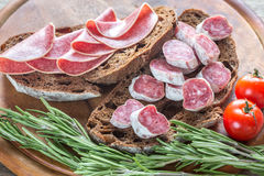 Sandwiches with salami Stock Photos