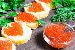 Sandwiches with salmon red caviar and herbs Stock Image