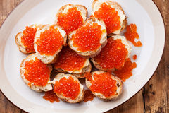 Sandwiches with Salmon red caviar Royalty Free Stock Image