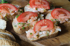 Sandwiches with salmon and tomato Royalty Free Stock Images