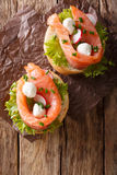 Sandwiches with salted salmon, mozzarella, frisee, onion and rad Royalty Free Stock Image