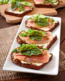 Sandwiches with salty salmon Stock Photos