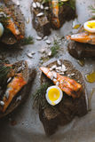 Sandwiches with sardines and quail eggs partial blur Royalty Free Stock Images