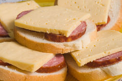 Sandwiches with sausage and cheese. Royalty Free Stock Photos