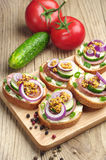 Sandwiches with sausage and onion Stock Image