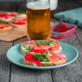Sandwiches with seafood and beer Royalty Free Stock Photo