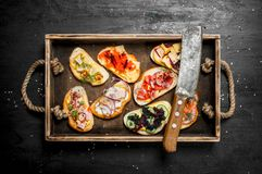 Sandwiches with seafood, meat and vegetables on fresh bread. stock image