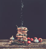 Sandwiches with smoked meat, tomato, garlic, cucumber and herbs Royalty Free Stock Images