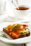 Sandwiches with smoked salmon and avocado Stock Photos