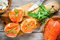 Sandwiches with smoked salmon with cream cheese, arugula Stock Photo