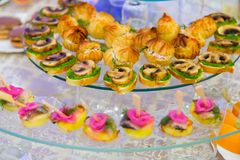 Sandwiches and snacks on the buffet table. Catering, event.  Royalty Free Stock Image