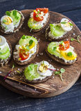 Sandwiches with soft cheese, quail eggs, cherry tomatoes and celery. Delicious healthy snack or Breakfast. Royalty Free Stock Photography