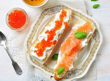 Sandwiches with soft cheese and smoked salmon caviar Royalty Free Stock Photo