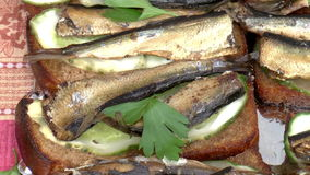 Sandwiches with sprats stock video footage