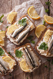 Sandwiches with sprats, cream cheese close-up. vertical top view Stock Images