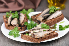 Sandwiches with sprats and green onion Royalty Free Stock Photography