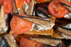 Sandwiches with sprats and tomatoes. Many sandwiches with sprats and tomatoes Royalty Free Stock Image
