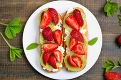 Sandwiches with strawberries Stock Images