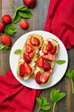 Sandwiches with strawberries and kiwi Royalty Free Stock Images