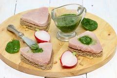 Sandwiches. Three fresh sub sandwiches with ham on a cutting board. Shallow DOF stock image
