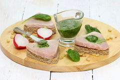 Sandwiches. Three fresh sub sandwiches with ham on a cutting board. Shallow DOF royalty free stock images