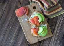 Sandwiches with trout and avocado on a white background. Healthy eating royalty free stock images