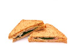 Sandwiches. Two ham,cheese,and lettuce, sandwiches on a white background Royalty Free Stock Photography