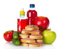 Sandwiches, vegetables, apples and bottles Stock Images