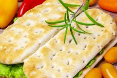 Sandwiches with vegetables around close up Royalty Free Stock Image
