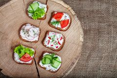Sandwiches with vegetables and feta cheese with tomato, cucumber Stock Photos