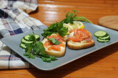 Sandwiches of white bread with red fish and butter Royalty Free Stock Photography