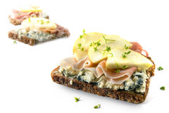 Sandwiches from whole grain with blue cheese, prosciutto ham, ap. Ple slices and cress garnish isolated on a white background, selective focus, narrow depth of Stock Photos