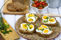 Sandwiches with of wholemeal bread with eggs and chives. Delicious sandwiches with of wholemeal bread with eggs and chives Stock Image