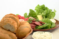Sandwiches will be prepared in just a moment. Close view at fresh sandwich ingredients put together Royalty Free Stock Photo