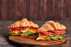 Sandwiches on a wooden light and dark background royalty free stock image