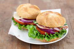 Sandwiches on Wooden Table Royalty Free Stock Images