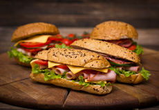 Sandwiches on the wooden table Royalty Free Stock Photography
