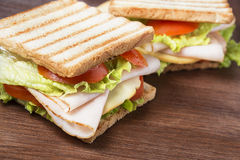 Sandwiches on wooden table stock photo