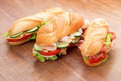 Sandwiches on wooden table Stock Images