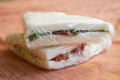 Sandwiches wrapped in transparent film. Stuffed take away sandwiches wrapped in transparent film Stock Photo