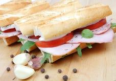 Sandwichs avec du jambon et le mozzarella de tomate Image stock