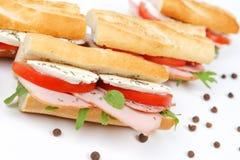 Sandwichs avec du jambon et le mozzarella de tomate Images libres de droits