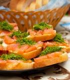 Sandwichs avec les poissons rouges Photographie stock libre de droits